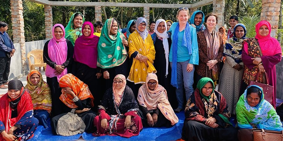 Photo of Joke Le Poole in Bangladesh with a group of Health Promotion Agents (entrepreneurs providing WASH awareness and selling WASH products in their communities).