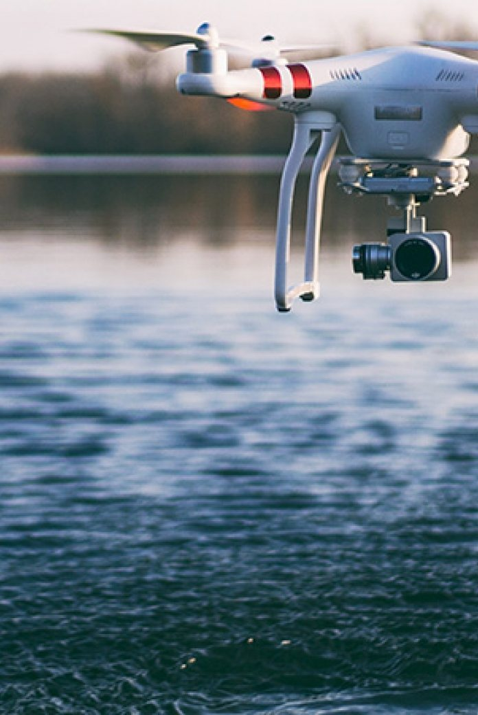 Photo of a drone recording information about water.